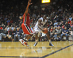 Ole MIss forward Reginald Buckner (2) drives against Georgia's Jeremy Price (50) at the C.M. &quot;Tad&quot; Smith Coliseum in Oxford, Miss. on Saturday, January 15, 2011. Georgia won 98-76.  (AP Photo/Oxford Eagle, Bruce Newman)
