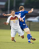 Winthrop University Eagles vs the Brevard College Tornados at Eagle's Field in Rock Hill, SC.  The Eagles beat the Tornados 6-0.  Adam Brundle (12) falls after a challenge from Ryan Vandenberg (6).