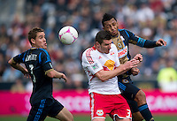 Kenny Cooper (33) of the New York Red Bulls collides on a header with Carlos Valdes (2) of the Philadelphia Union during the game at PPL Park in Chester, PA.  New York defeated Philadelphia, 3-0.