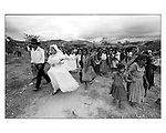 A Native Zapoteco newly married couple walks along with the villagers after being married in a traditional wedding in Coatecas Altas village, in Oaxaca state. Photo by Heriberto Rodriguez