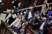 Roma March 10, 2015. Approvata alla Camera dei Deputati la riforma della Costituzione. nella foto: I deputati di SEL tengono alto in mano il testo della Costituzione durante la votazione.