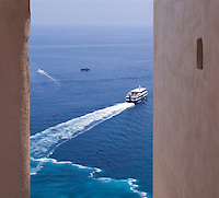 Narrow view, walls. Ship at sea. Positano at Amalfi Coast, Campania, Italy, World Heritage Site.