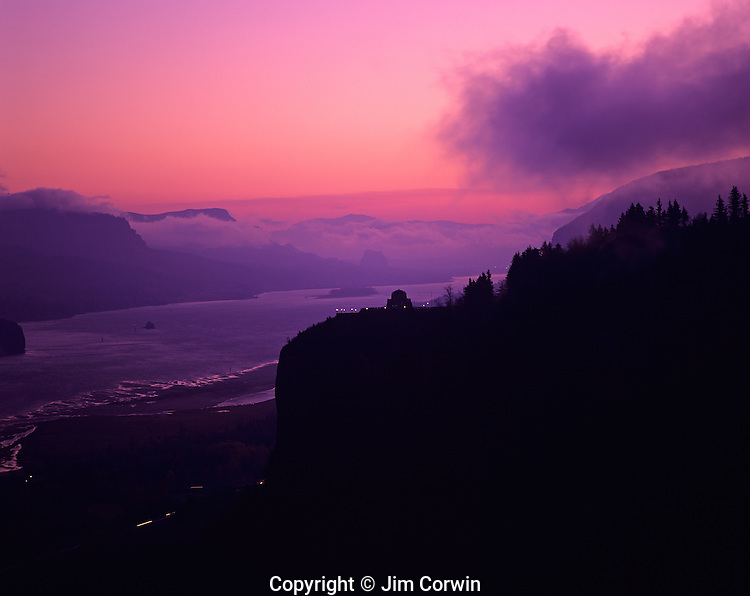 Columbia River Gorge National Scenic Area Crown Point State Scenic Corridor Crown Point with Vista House lookout and observatory silhouetted sunrise with dramatic light Oregon State USA
