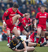 Nils Mordt of Saracens RFC narrowly avoids his clearance being charged down - London Wasps RFC vs Saracens RFC - Aviva Premiership Rugby at Adams Park, Wycombe Wanderers FC - 12/02/12 - MANDATORY CREDIT: Ray Lawrence/TGSPHOTO - Self billing applies where appropriate - 0845 094 6026 - contact@tgsphoto.co.uk - NO UNPAID USE.