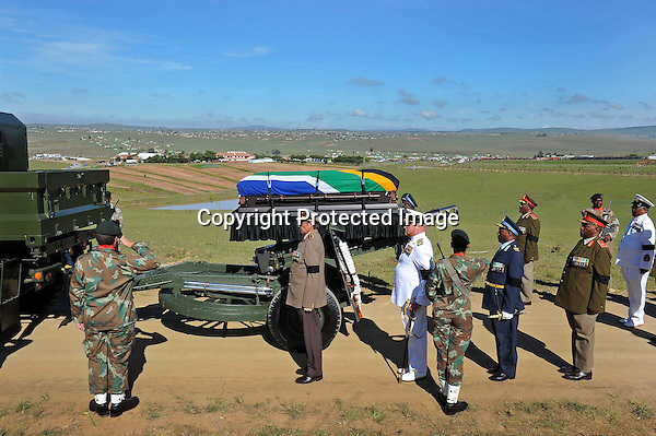 (The Casket of the late Former President Nelson Mandela' carried on the army gun carriage arrives at the marquee at his home). Funeral service of the Late Former President Nelson Mandela 15/12/2013, Elmond Jiyane, GCIS