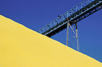 Yellow sulfur piles with blue sky