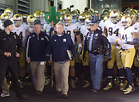 Notre Dame head coach Brian Kelly leads his team onto the field. The Pittsburgh Panthers defeated the Notre Dame Fighting Irish 28-21 at Heinz Field, Pittsburgh, Pennsylvania on November 9, 2013.