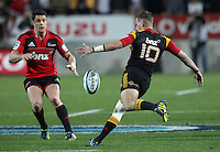 Chiefs' Aaron Cruden makes a kick past Crusaders' Dan Carter in the semi-final Super Rugby match, Waikato Stadium, Hamilton, New Zealand, Friday, July 27, 2012.  Credit:SNPA / David Rowland