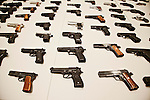 LA Mayor Antonio Villaraigosa and local law enforcement and city officials hold a press conference about the city's gun buy back program held yesterday.. 901 handguns, 698 rifles, 363 shotguns and 75 assault weapons were collected yesterday. Gift cards for Ralph's supermarket, ranging from $50-$200, were traded for the guns. The gift cards were donated to the city's buyback program. Two rocket launchers were also turned in..Hand guns turned in on display.