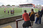 Supporters of Alloa Athletc football club (in yellow) celebrating their team's goal at Ochilview stadium, Larbert, during their Irn Bru Scottish League second division match against Stenhousemuir. Alloa won the match by one goal to nil against their local rivals in a match watched by 619 spectators. The goal was scored by Alloa's number 9 Brian Prunty.