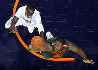 CHARLOTTESVILLE, VA- JANUARY 7: Reggie Johnson #42 of the Miami Hurricanes reaches for the rebound next to Assane Sene #5 of the Virginia Cavaliers during the game on January 7, 2012 at the John Paul Jones Arena in Charlottesville, Virginia. Virginia defeated Miami 52-51. (Photo by Andrew Shurtleff/Getty Images) *** Local Caption *** Assane Sene;Reggie Johnson
