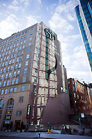 The Carl Fischer music publishers sign and clock on the side of 62 Cooper Square in the East Village neighborhood of New York is seen on Saturday, January 28, 2012.  The clock no longer functions and the building was converted to condos in 2001. (© Richard B. Levine)