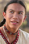 A Native American teenage Indian boy smiling