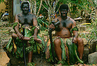 Traditional Fijian Warrior Guards wearing grass skirts and face paints, Fiji, South Pacific