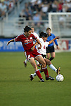 19 June 2003: Birgit Prinz (left) of Germany and the Carolina Courage loses the ball to Joy Fawcett (right) of the San Diego Spirit. The WUSA World Stars defeated the WUSA American Stars 3-2 in the WUSA All-Star Game held at SAS Stadium in Cary, NC.