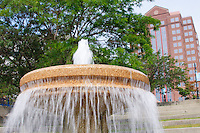 A fountain flows in Promenade Park in downtown Toledo, Ohio with the HCR ManorCare building framed in the background.