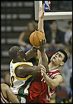 Houston Rockets' Yao Ming of China (R) fouls Seattle SuperSonics' Reggie Evans during the fourth period of their game at Key Arena in Seattle, Washington Monday, 11 April 2005.