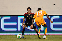 Mexico forward Damian Alvarez (7) is marked by Ivory Coast defender Brice Dja Djedje (15). Mexico defeated the Ivory Coast 4-1 during an international friendly at MetLife Stadium in East Rutherford, NJ, on August 14, 2013.