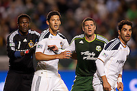Lining up for a corner kick (from L - R) LA Galaxy GK Donovan Ricketts, Omar Gonzalez, Kenny Cooper and Juan Pablo Angel. The LA Galaxy defeated the Portland Timbers 3-0 at Home Depot Center stadium in Carson, California on  April  23, 2011....
