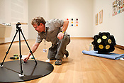 "August 25, 2010. Durham, North Carolina.. Chief Preparator Brad Johnson, work sin the main gallery..The installation of ""The Record, Contemporary Art and Vinyl"" the new exhibit at the Nasher Museum of Art that explores the culture of vinyl records through 50 years of contemporary art."