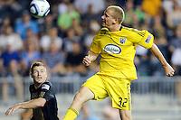 Steven Lenhart (32) of the Columbus Crew heads the ball on goal. The Columbus Crew defeated the Philadelphia Union 2-1 during a Major League Soccer (MLS) match at PPL Park in Chester, PA, on August 05, 2010.