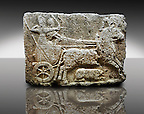 Picture & image of a Neo-Hittite orthostat with a chariot Releif sculpture from Karkamis,, Turkey. Ancora Archaeological Museum. The Cahiot is pulled by horses with plumed headresses. One man os about to shoot an arrow from his bow, the other man is driving the cahriot. Below the horse is a animal cowering. 3