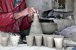 Africa, Morocco, Fes. Artisan spinning Morrocan ceramics.