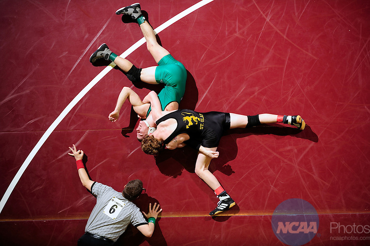 12 MAR 2011: Chris Albright of York takes on Ryan Timmerman of St. Olaf in the men's 141 lbs third place semifinals during the Division III Men's Wrestling Championship held at the La Crosse Center in La Crosse Wisconsin. Stephen Nowland/NCAA Photos