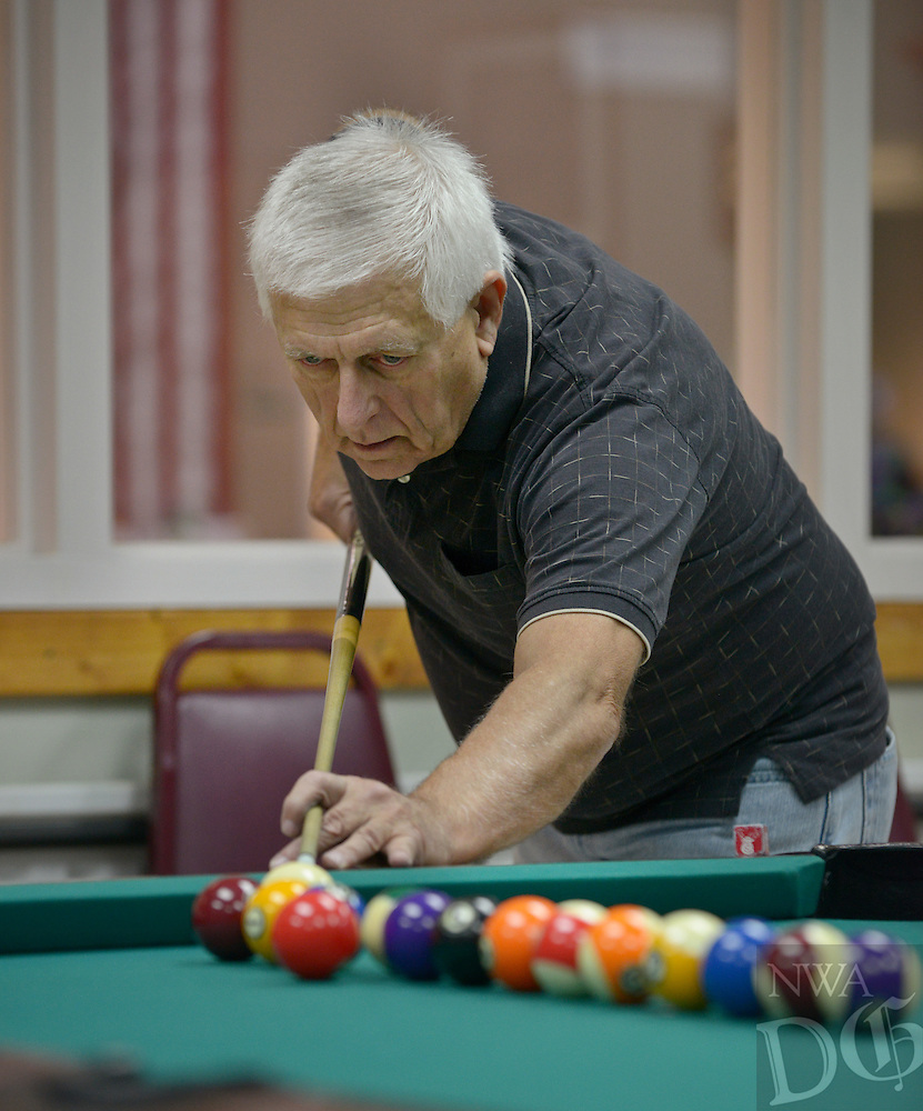 NWA Democrat-Gazette/BEN GOFF @NWABENGOFF<br /> Bill Jefferson of Bentonville works on his technique on Monday Feb. 8, 2016 while shooting pool at the Benton County Senior Activity and Wellness Center in Bentonville.