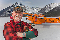 Noted bush pilot Art Mortvedt with his plane the organge pumkin at his cabin on Shelby lake in the Gates of the Arctic National Park, Alaska.
