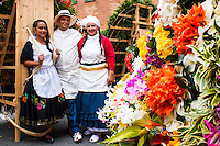 A family of silleteros wait for participate on the 58th Silleteros' parade in the framework of the flowers' fair, this year the parade was declared intangible heritage of Colombia. Medellín, Colombia 09/08/2015