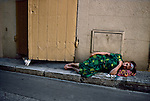 00214_14, FRANCE-10044, France, 1988. A woman lying in the street.