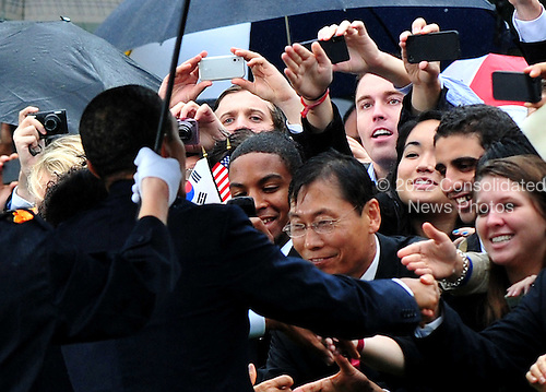 United States President Barack Obama greets guests during a welcome ceremony for  South Korean President Lee Myung-bak on the South Lawn of the White House in Washington, D.C. on Thursday, October 13, 2011. .Credit: Kevin Dietsch / Pool via CNP