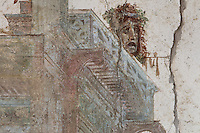 Fresco detail of a classical tragedy theatre mask and architectural section of the court of Bacchus, in the Triclinium, probably used for lunches, a large room open to the garden, with walls painted on a white background with figures and plants and ornamental borders and floating figures of the seasons, in the Casa dell Efebo, or House of the Ephebus, Pompeii, Italy. This room is decorated in the Fourth Style of Roman wall painting, 60-79 AD, a complex narrative style. This is a large, sumptuously decorated house probably owned by a rich family, and named after the statue of the Ephebus found here. Pompeii is a Roman town which was destroyed and buried under 4-6 m of volcanic ash in the eruption of Mount Vesuvius in 79 AD. Buildings and artefacts were preserved in the ash and have been excavated and restored. Pompeii is listed as a UNESCO World Heritage Site. Picture by Manuel Cohen
