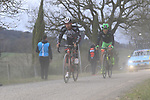 The tail enders on gravel sector 4 Commune di Murlo during the 2017 Strade Bianche running 175km from Siena to Siena, Tuscany, Italy 4th March 2017.<br /> Picture: Eoin Clarke | Newsfile<br /> <br /> <br /> All photos usage must carry mandatory copyright credit (&copy; Newsfile | Eoin Clarke)