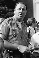 July 19th 1969, Chappaquiddick, Edgartown, Martha's Vineyard, Massachusetts<br /> Officer Arena talking to reporters after arresting Edward Ted Kennedy and finding Mary Jo Kopechne's body. Kopechne was killed when Edward T. Kennedy drove off a rural road on Chappaquiddick Island into a pond in 1969.