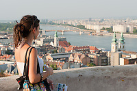 Tourist enjoys the view on a summer sightseeing in Budapest, Hungary on August 25, 2011. ATTILA VOLGYI