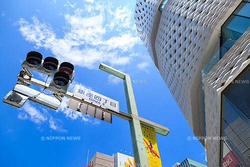 A traffic light next to Ginza Place building under construction in Ginza shopping area on June 17, 2016, Tokyo, Japan. Set in an upscale shopping area, the 11-story Ginza Place shopping complex will feature stores and restaurants along with the Nissan showroom. It will also temporarily house the Sony showroom after Sony Plaza closes in March 2017. (Photo by Rodrigo Reyes Marin/AFLO)