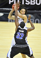 Quinard Jackson of the Bulldogs plays tough defense against Panthers' Gary McGhee. Pittsburgh defeated UNC-Asheville 74-51 during the NCAA tournament at the Verizon Center in Washington, D.C. on Thursday, March 17, 2011. Alan P. Santos/DC Sports Box