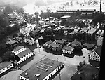 Aerial view of a flooded residential area in Ansonia on October 16, 1955. In the background is the Naugatuck River.