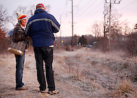 NWA Democrat-Gazette/DAVID GOTTSCHALK - 1/30/15 - Kevin Fitzpatrick (right),  professor of sociology and director of the University of Arkansas' Community and Family Institute, asks Angela Ritter answers questions near the woods where she lives south of Martin Luther King Jr. Boulevard in Fayetteville Friday January 30, 2015 at sunrise. Ritter participated in the Northwest Arkansas' biennial, 24-hour homeless census.