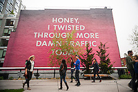 """Honey, I Twisted Through More Damn Traffic Today"" by the artist Ed Ruscha is seen along the High Line Park in New York on Saturday, May 10, 2014. The painting is Ruscha's first public commission in New York and is a reinterpretation of his 1977 pastel drawing. Considering how crowded the High Line Park can be the mural could be considered a metaphor for the human traffic on the elevated park as opposed to the literal vehicle traffic in Los Angeles where Ruscha lives and works. (© Richard B. Levine)"