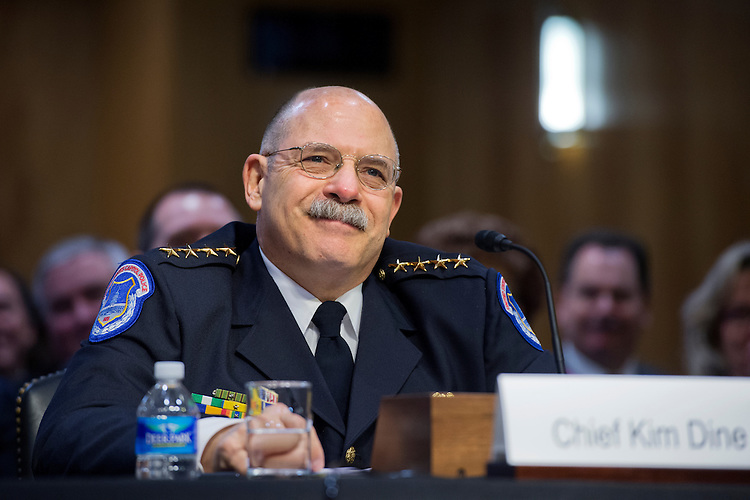 UNITED STATES - MARCH 12: U.S. Capitol Police Chief Kim Dine prepares to testify during a Senate Appropriations Legislative Branch Subcommittee hearing in Dirksen Building on FY2016 budget requests for the Secretary of the Senate, Senate Sergeant at Arms, and the U.S. Capitol Police, March 12, 2015. (Photo By Tom Williams/CQ Roll Call)