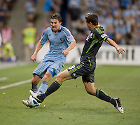 Matt Besler, Marc Burch. Sporting Kansas City won the Lamar Hunt U.S. Open Cup on penalty kicks after tying the Seattle Sounders in overtime at Livestrong Sporting Park in Kansas City, Kansas.