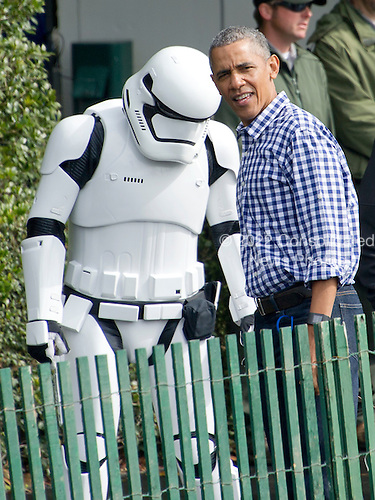United States President Barack Obama walks towards the storybook area &quot;protected&quot; by a Star Wars storm trooper as he and first lady Michelle Obama host the 2016 White House Easter Egg Roll on the South Lawn of the White House in Washington, DC on Monday, March 28, 2016.<br /> Credit: Ron Sachs / CNP