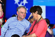 Harrisburg, PA - July 29, 2016: Democratic vice presidential candidate Sen. Tim Kaine and his wife, Anne Holton, talk on stage as Hillary Clinton speaks to supporters at the Broad Street Market in Harrisburg, PA, during a campaign stop on the Clinton/Kaine bus tour July 29, 2016.  (Photo by Don Baxter/Media Images International)