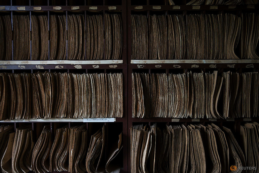 Some of hundreds of medical and X-ray files are stored at radiology department of Yangjia Hospital in Wuji County, China's Zhejiang Province October 19, 2015. Behinds walls and broken windows of radiology department covered with creeping vines, a single member of staff and a single X-ray machine serve few remaining pneumoconiosis patients of Yangjia Hospital. The hospital, once considered top medical institution with latest imported equipment became private after the mine company that built it went broke in 2001. Since that time Yangjia Hospital is not able to keep the high standards and is now offering only basic care for its remaining patients.    REUTERS/Damir Sagolj