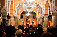 Australian violinist Niki Vasilakis speaks on stage before she plays the violin during a recital at the OzFest Gala Dinner in the Jaipur City Palace, in Rajasthan, India on 10 January 2013. Photo by Suzanne Lee