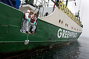 Crew from the Greenpeace ship Rainbow Warrior collect sea water samples to monitor radiation contamination levels, as the ship sails up the eastern coast of Japan, in the vicinity of Fukushima, in Japan, Tuesday 3rd May 2011.
