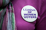 A volunteer with the League of Women Voters of the Los Altos-Mountain View Area shows off her button and bright smile.
